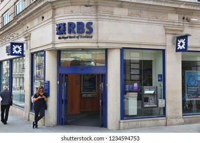 LONDON, UK - JULY 7, 2016: Person waits in front of RBS Royal Bank of Scotland branch in London. RBS has 700 branches, most of them in Scotland.