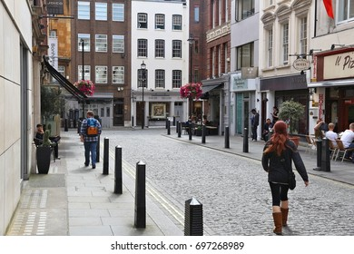 LONDON, UK - JULY 7, 2016: People shop at New Bond Street in London. Bond Street is a major shopping street in the West End of London.