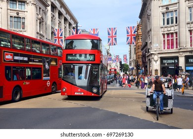 LONDON, UK - JULY 7, 2016: People visit Oxford Circus in London. London is the most populous city in the UK with 13 million people living in its metro area.