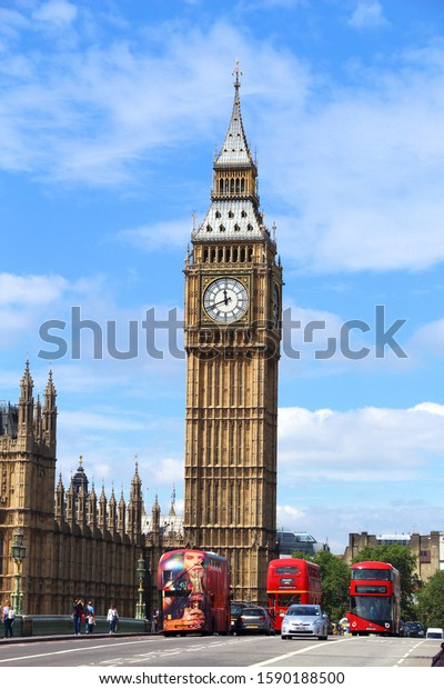 LONDON, UK - JULY 7, 2016: People walk near Big Ben in London, UK. London is the most populous city in the UK with 13 million people living in its metro area.