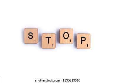 LONDON, UK - JULY 7TH 2018: The word STOP, spelt with wooden letter Scrabble tiles, on 7th July 2018.