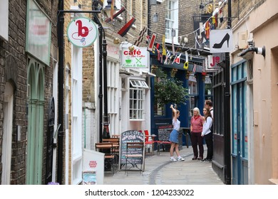 LONDON, UK - JULY 8, 2016: People walk in Greenwich, London, UK. Royal Borough of Greenwich is a part of London with population of 274,800.