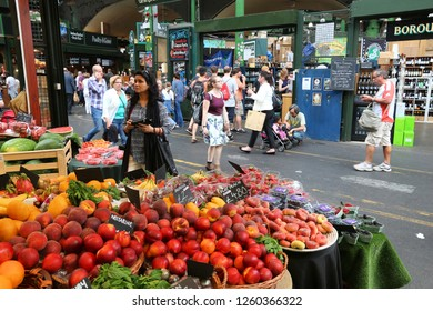 LONDON, UK - JULY 8, 2016: People shop at Borough Market in Southwark, London. It is one of oldest markets in Europe. Its 1,000th birthday was in 2014.