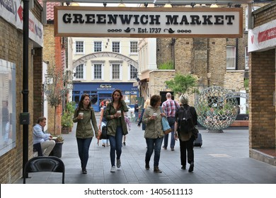 LONDON, UK - JULY 8, 2016: People visit Greenwich Market in London, UK. Royal Borough of Greenwich is a part of London with population of 274,800.