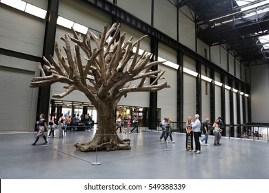 LONDON, UK - JULY 8, 2016: People visit Tate Modern Gallery in London, UK. The gallery is located in the Bankside area of the London Borough of Southwark.