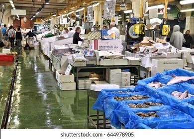LONDON, UK - JULY 8, 2016: Vendors sell sea food at Billingsgate Fish Market in London, UK. The market is located at Isle of Dogs and is one of largest fish markets in the world.