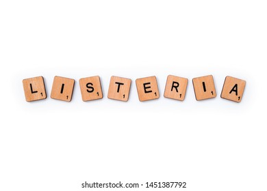 London, UK - July 8th 2019: The word LISTERIA, spelt with wooden letter tiles, over a plain white background.