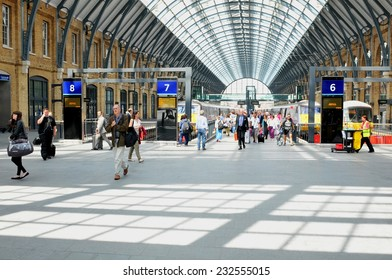 LONDON, UK - JULY 9, 2014: People transit the King's Cross train station in central London.