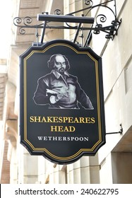 LONDON, UK - JULY 9, 2014: Sign of traditional English pub Shakespeare's Head Wetherspoon in central London
