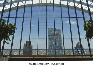 LONDON, UK - JULY 9, 2015: View from the SkyGarden at 20 Fenchurch Street towards The Leadenhall Building. Designed by Rafael Vinoly, 20 Fenchurch Street it is often referred to as the Walkie-Talkie.