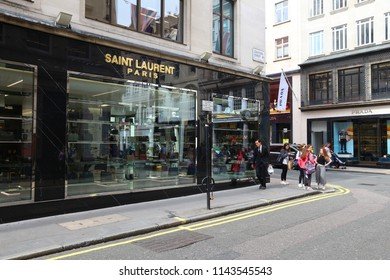 LONDON, UK - JULY 9, 2016: People walk by Saint Laurent fashion shop at Mayfair, London. Mayfair is a major shopping area in the West End of London.