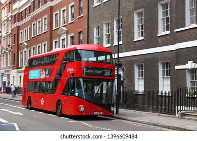 LONDON, UK - JULY 9, 2016: People ride New Routemaster bus in City of London. The hybrid diesel-electric bus is a new, modern version of iconic double decker.