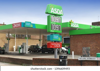 LONDON, UK - JULY 9, 2016: Petrol prices at Asda gas station in London. Asda operates more than 300 petrol stations in the UK. Asda is part of Walmart group.