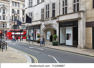 LONDON, UK - JULY 9, 2016: Shoppers visit fashion shops at Old Bond Street in London. Bond Street is a major shopping street in the West End of London.
