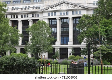 LONDON, UK - JULY 9, 2016: People enjoy summer in Bloomsbury Square Garden in London. The building in background is the Museums, Libraries and Archives Council.
