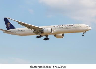 LONDON, UK - JULY 9, 2017: Boeing 777 Saudi Arabian Airlines landing at London Heathrow airport