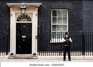 LONDON, UK - JUN 16: A  police officer guards the door of 10 Downing Street in London on June 16, 2013 as British PM David Cameron meets Russian President Vladimir Putin to discuss Syria ahead of G8.