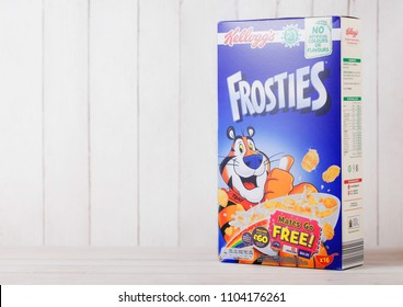 LONDON, UK - JUNE 01, 2018: Box of Kellogg's Frosties Breakfast Cereal on white wooden background, Frosties are a popular breakfast cereal made from sugar coated corn flakes.