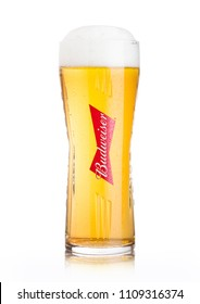 LONDON, UK - JUNE 02, 2018: Cold original glass of Budweiser Beer on white background, an American lager first introduced in 1876.