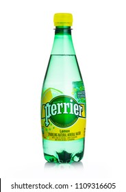 LONDON, UK - JUNE 02, 2018: Plastic Bottle of Perrier sparkling water with lemon flavour. Perrier is a French brand of natural bottled mineral water sold worldwide.