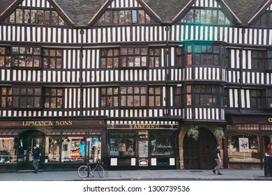 London, UK - June 03, 2017: People walking past Lipman & Sons and Sanford shops located in tudor style building in the City of London, city's famous financial district.