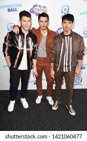 LONDON, UK. June 08, 2019: Jonas Brothers poses on the media line before performing at the Summertime Ball 2019 at Wembley Arena, London