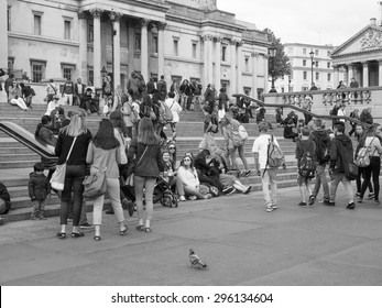LONDON, UK - JUNE 09, 2015: Tourists visiting Trafalgar Square in front of the National Gallery in black and white
