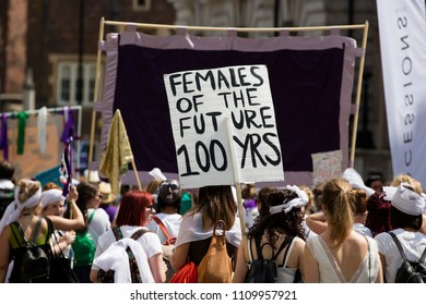 LONDON, UK - JUNE 10th 2018: Thousands of woman and girls march in London celebrating 100 years of the women's vote and gender equality, organised by 14-18 Now and artichoke.