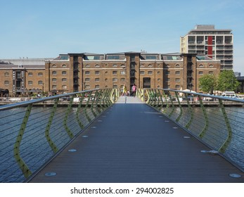 LONDON, UK - JUNE 11, 2015: Tourists visiting West India Quay in Docklands