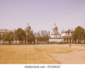 LONDON, UK - JUNE 11, 2015: The Canary Wharf business centre which is the largest business district in the United Kingdom seen from Greenwich park vintage
