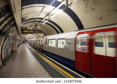 London UK June 11th 2015 : A tube train leaving a London Underground station