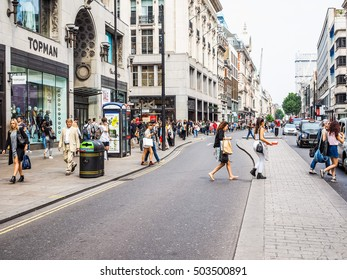 LONDON, UK - JUNE 12, 2015: Tourists in busy central London street (HDR)