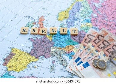 London, UK - June 12, 2016: Brexit word with euro money on european map.  The United Kingdom European Union membership referendum on 23 June 2016