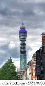 LONDON, UK, JUNE 12: Colorful HDR image of the BT Tower, a prominent London building  and HQ of British multinational telecommunications company on HDR cloudy sky, London, UK, June 12, 2019