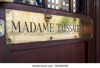 London, Uk - JUNE 12TH, 2015 - Detail of entrance of Madame Tussaud's museum with brass ensign and wooden door.