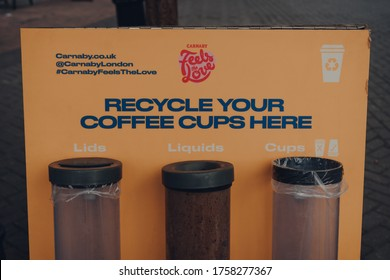 London, UK - June 13, 2020: Carnaby Feels The Love coffee cups recycling station in Carnaby Street, London, a pedestrianised shopping street in Soho with over 100 shops and restaurants.