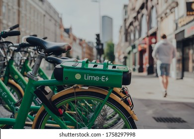 London, UK - June 13, 2020: Dockless Lime E electric bike on a street in London, selective focus. Bike sharing company Lime, by Californian transportation company, arrived to London in December 2018