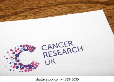LONDON, UK - JUNE 13TH 2016: A close-up of the Cancer Research UK logo on the top of a letter, taken in London on 13th June 2016.