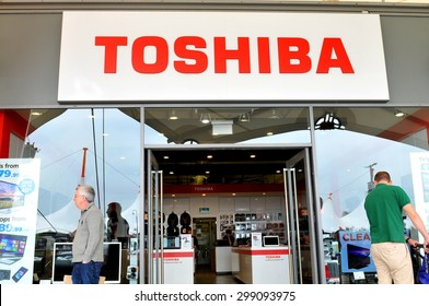 London, UK - June 14, 2015: Detail of the entrance to a Toshiba store. Toshiba is a famous Japanese multinational corporation whose products and services include IT and communications equipment.