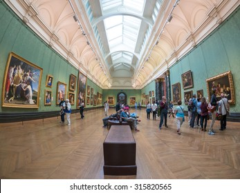 LONDON, UK - JUNE 14, 2015: The National Gallery in Trafalgar Square. People visit the rooms of the National Gallery.