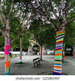 LONDON/ UK- JUNE 14 2018: Trees decorated with woollen patterns, at the folk and craft fair in Barking abbey, London.