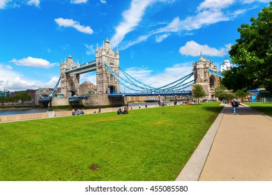 London, UK - June 15, 2016: Tower Bridge in London with unidentified people. The Tower Bridge crossing the river Thames is an iconic symbol of London.