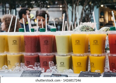 London, UK - June 15, 2019: Fresh cold pressed juice on sale at Spitalfields Market, one of the finest surviving Victorian Market Halls in London with stalls offering fashion, antiques and food.