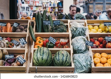 London, UK - June 15, 2019: Fresh fruit and veg in crates on sale at Spitalfields Market, one of the finest surviving Victorian Market Halls in London with stalls offering fashion, antiques and food.
