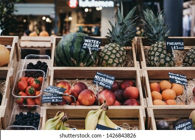 London, UK - June 15, 2019: Fresh fruits in crates on sale at Spitalfields Market, one of the finest surviving Victorian Market Halls in London with stalls offering fashion, antiques and food.