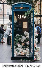 London, UK - June 15, 2019: Flower decorated phone booth sponsored by Daniel Wellington inside Spitalfields Market, one of the finest Victorian Markets in London offering fashion, antiques and food.
