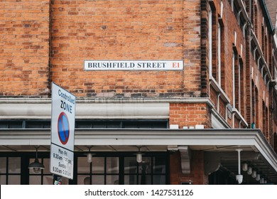 London, UK - June 15, 2019: Brushfield Street name sign on a wall of Spitalfields Market, one of the finest Victorian Markets in London offering fashion, antiques and food.