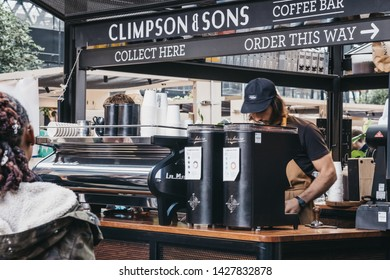 London, UK - June 15, 2019: People order coffee at Climpson & Sons stand inside Spitalfields Market, one of the finest Victorian Market Halls in London with stalls offering fashion, antiques and food.