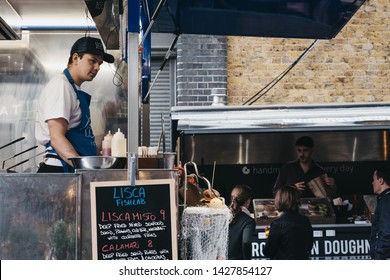 London, UK - June 15, 2019: Food stalls  inside Spitalfields Market, one of the finest surviving Victorian Market Halls in London with stalls offering fashion, antiques and food.
