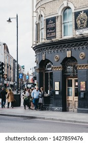 London, UK - June 15, 2019: People drinking outside The Old Blue Last pub in Shoreditch, a trendy area of Londons East End that is home to an array of markets, bars and restaurants.